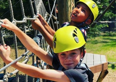 kids climbing at wild blue ropes